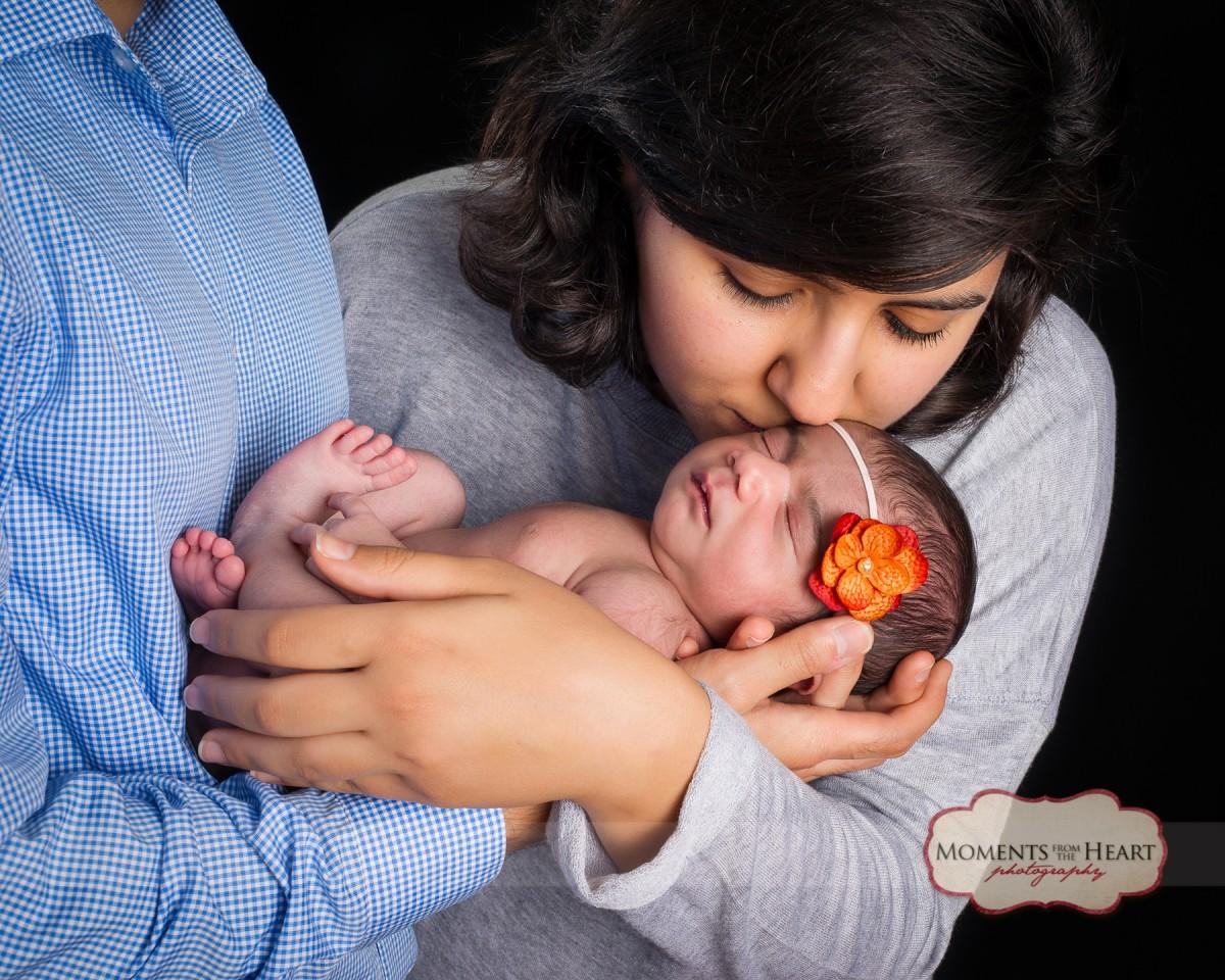 safe in parents arms newborn