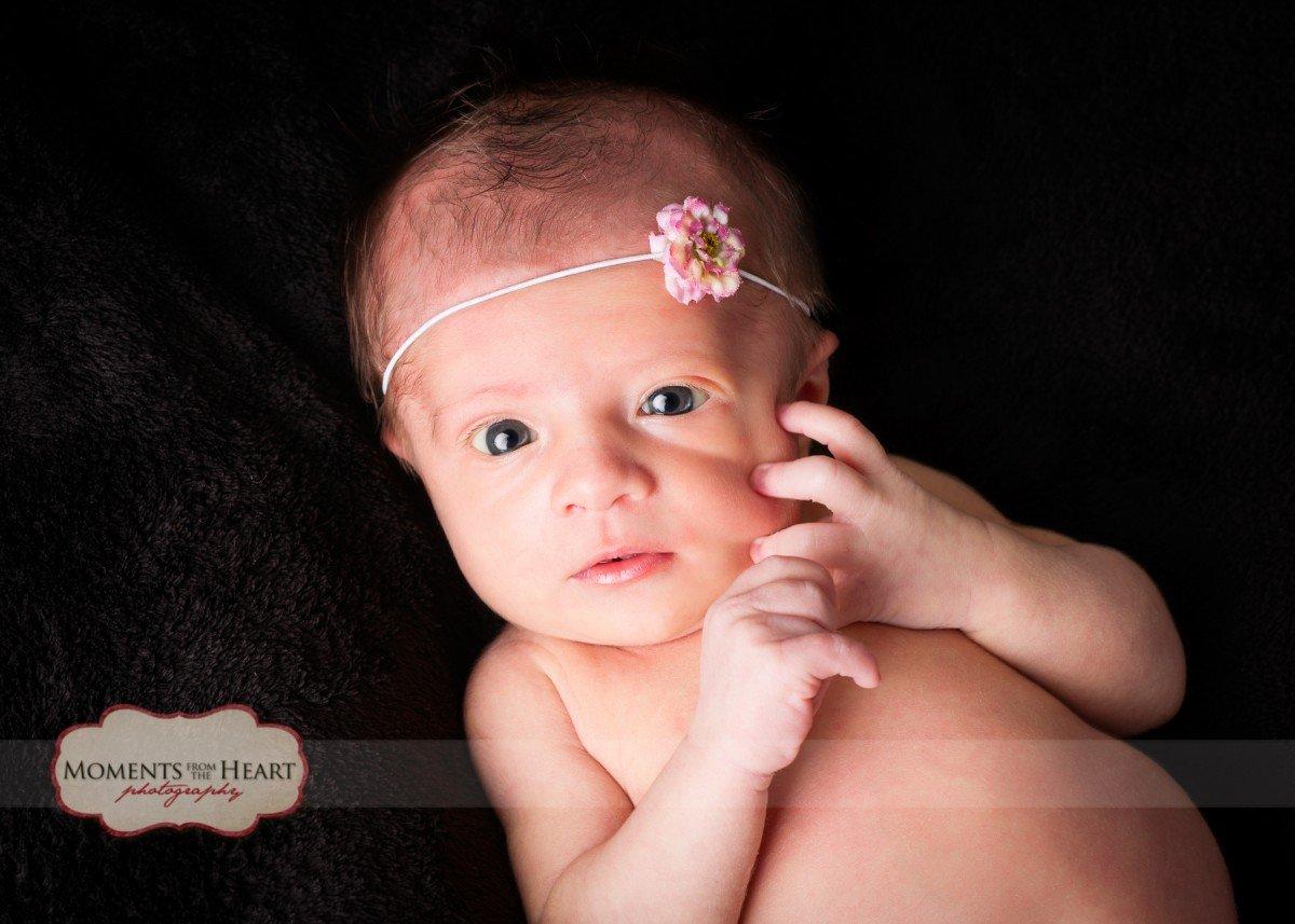 newborn with flower headband