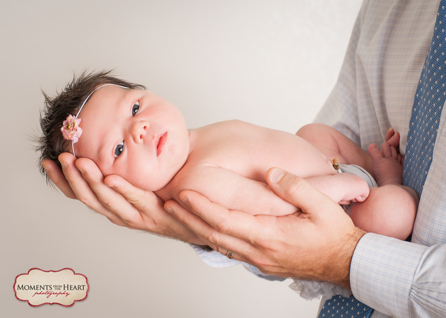 Dad and Newborn Studio Photography session - New dad holding beautiful newborn daughter ~ Austin, TX