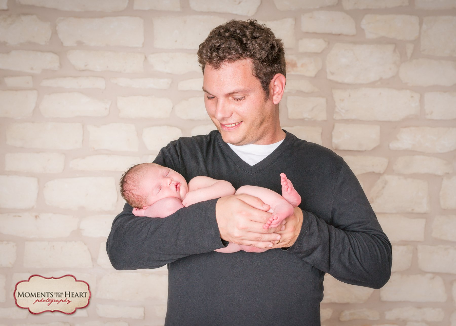 Dad and Newborn Studio Photography session - Proud new dad holding newborn ~ Austin, TX