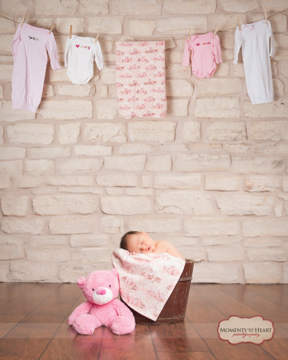 newborn with laundry