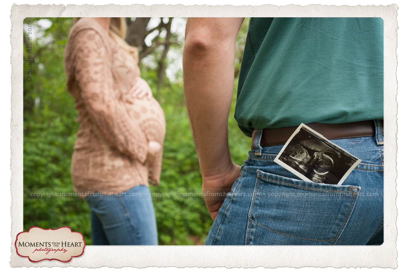 outdoor maternity couple with ultrasound baby photo