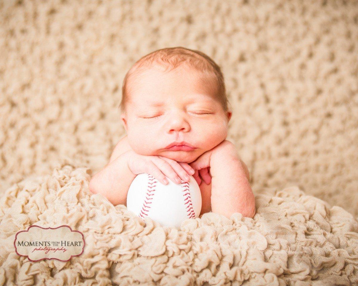 newborn with baseball