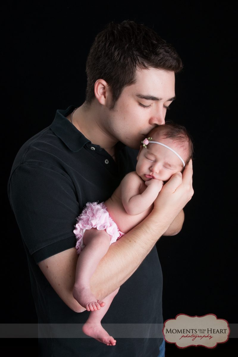 proud daddy newborn baby photo