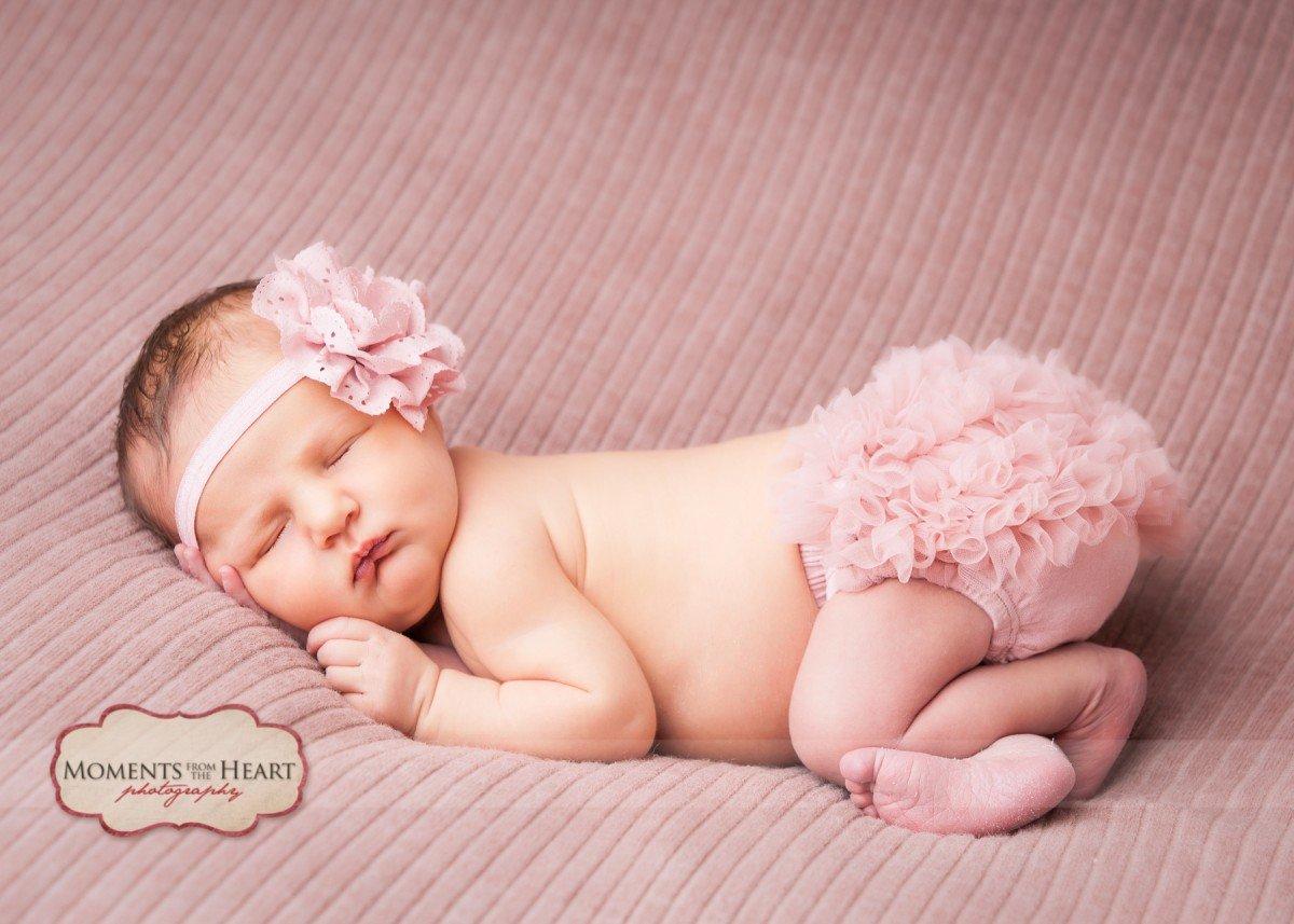 newborn in pink ruffles